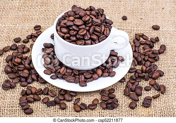 Cup full of coffee beans - csp52211877
