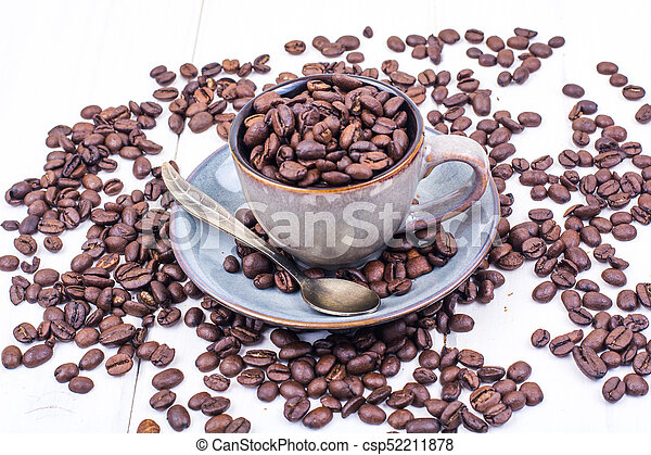 Cup full of coffee beans - csp52211878