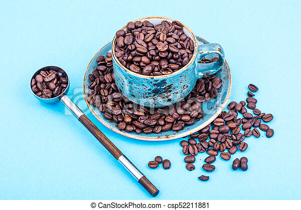 Cup full of coffee beans - csp52211881