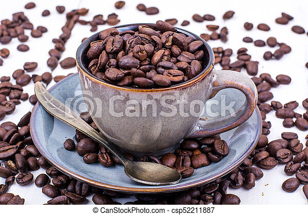 Cup full of coffee beans - csp52211887