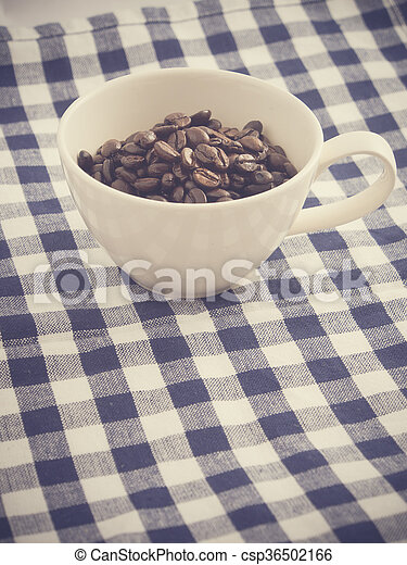 Cup full of coffee beans - csp36502166