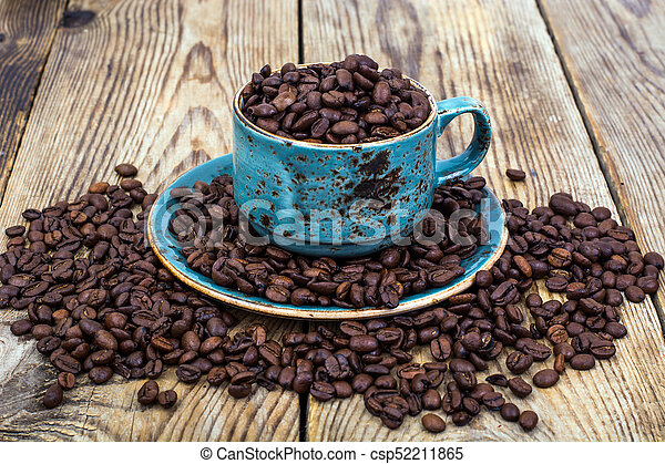 Cup full of coffee beans - csp52211865