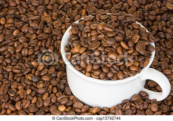 Cup full of coffee beans - csp13742744