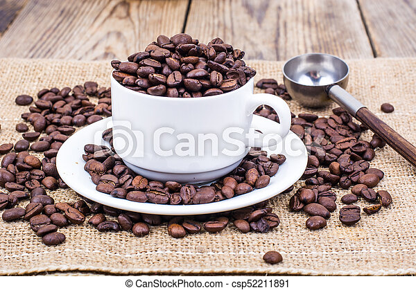 Cup full of coffee beans - csp52211891