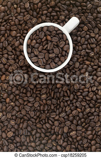 Cup full of coffee beans - csp18259205