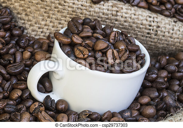 cup full of coffee beans - csp29737303