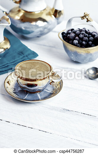 cup of black coffee espresso on a white wooden surface - csp44756287