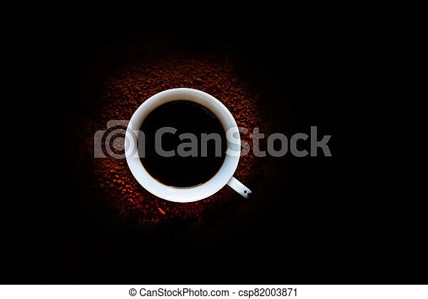 Cup of black coffee on a dark background - csp82003871