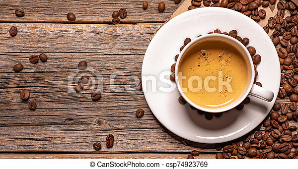 Cup of black coffee on a wooden background. - csp74923769