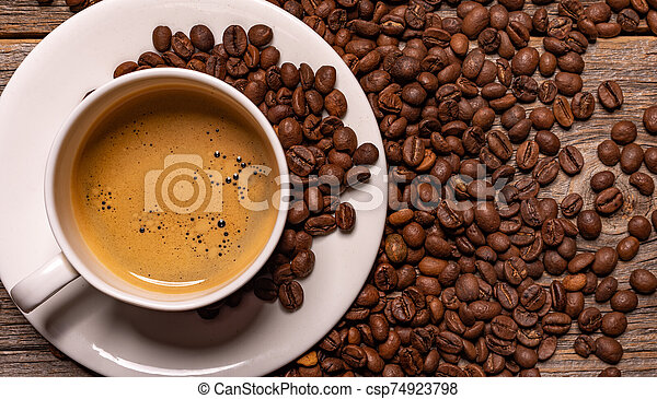 Cup of black coffee on a wooden background. - csp74923798