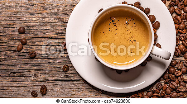 Cup of black coffee on a wooden background. - csp74923800