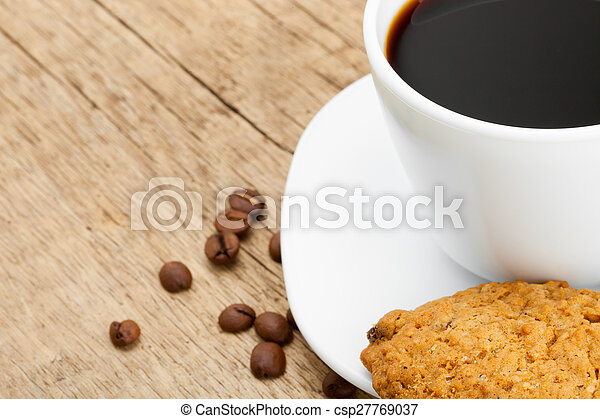Cup of black coffee with cookies on old wooden table - csp27769037