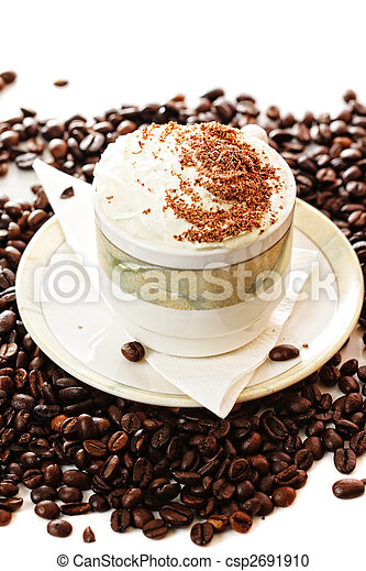 Cup of cappuccino coffee on beans - csp2691910