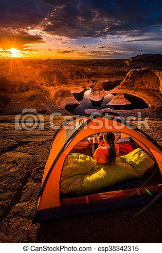 Cup of Coffe at Sunrise Reflection Canyon Utah Lake Powell Camping - csp38342315