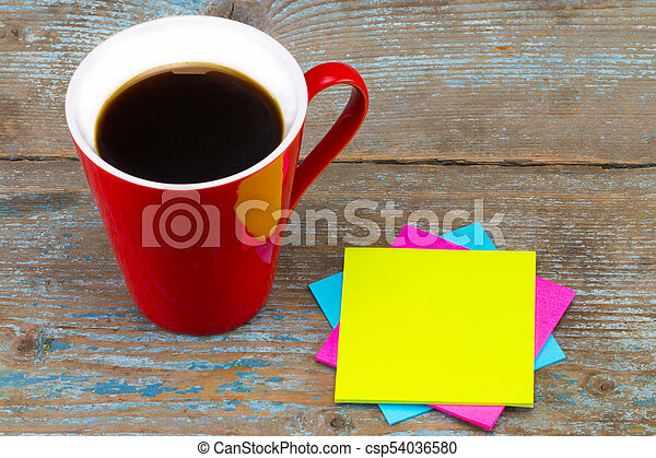 Cup of coffee and a  sticky notes with empty space for a text on wooden background - csp54036580