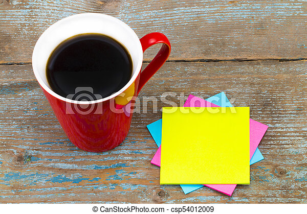 Cup of coffee and a  sticky notes with empty space for a text on wooden background - csp54012009