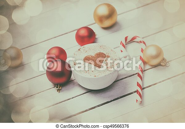 Cup of coffee and christmas candy - csp49566376