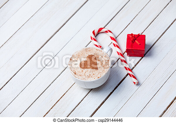 Cup of coffee and christmas candy - csp29144446