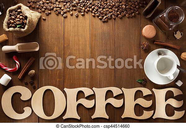 cup of coffee and letters on wood - csp44514660