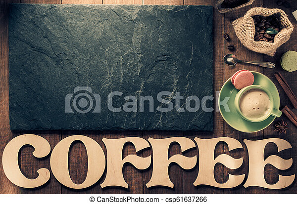 cup of coffee and letters on wood - csp61637266