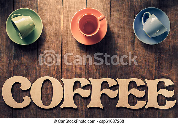 cup of coffee and letters on wood - csp61637268