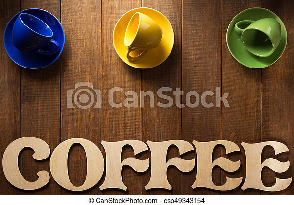 cup of coffee and letters on wood - csp49343154