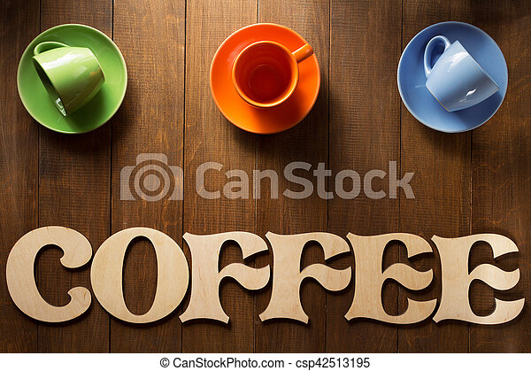 cup of coffee and letters on wood - csp42513195