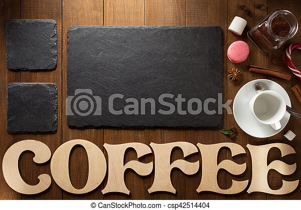 cup of coffee and letters on wood - csp42514404