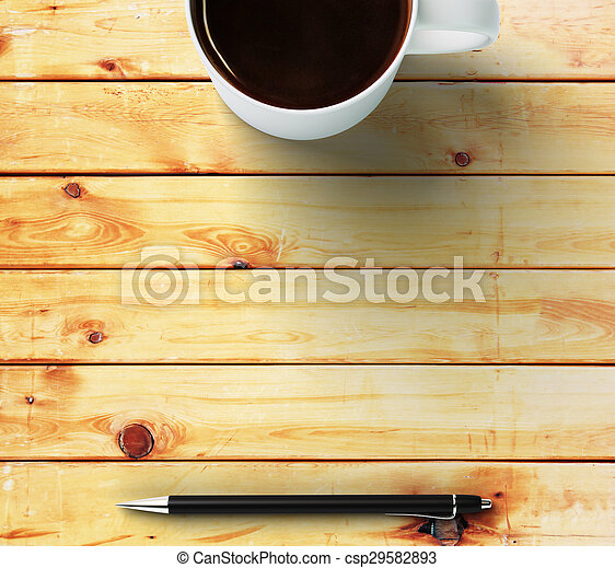 cup of coffee and pen on a wooden table with place for your text - csp29582893