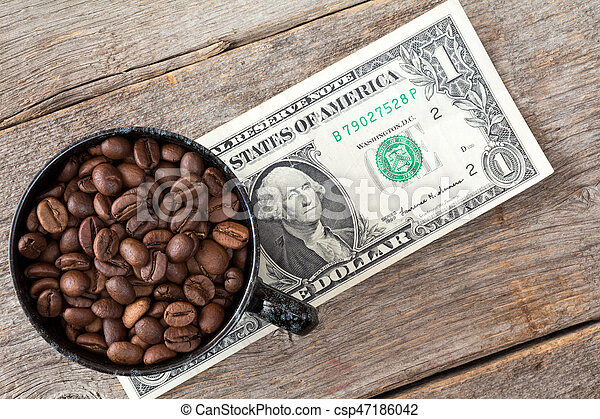 Cup of coffee beans on dollar banknote - csp47186042