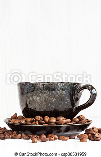 Cup of coffee on a white wood background - csp30531959