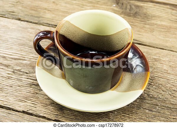 Cup of coffee on a wooden background - csp17278972