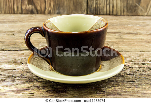 Cup of coffee on a wooden background - csp17278974