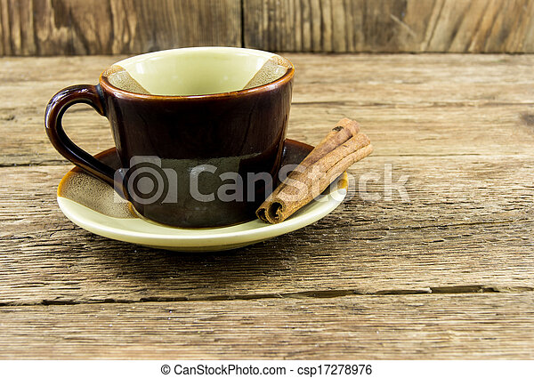 Cup of coffee on a wooden background - csp17278976