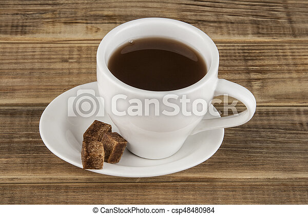 Cup of coffee on a wooden background - csp48480984