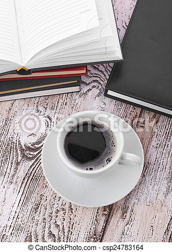 Cup of coffee on a wooden table - csp24783164