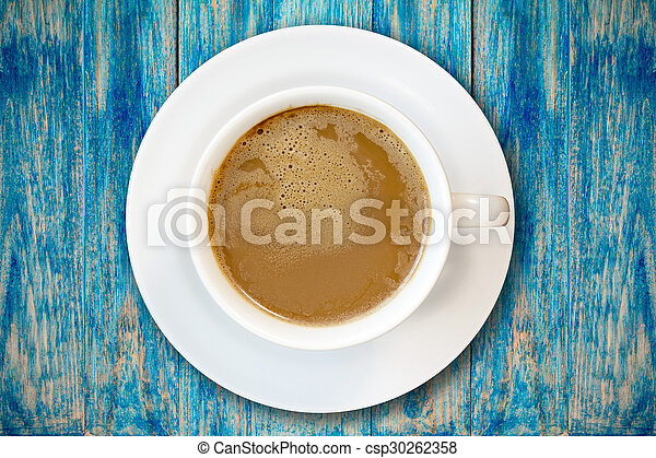 Cup of coffee on blue wooden surface - csp30262358