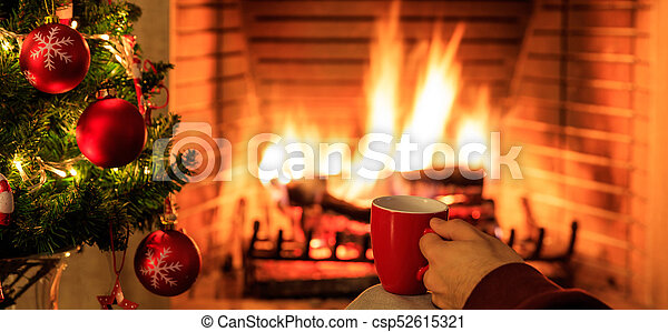 Burning Christmas Tree.Cup Of Coffee On Christmas Tree And Burning Fireplace Background