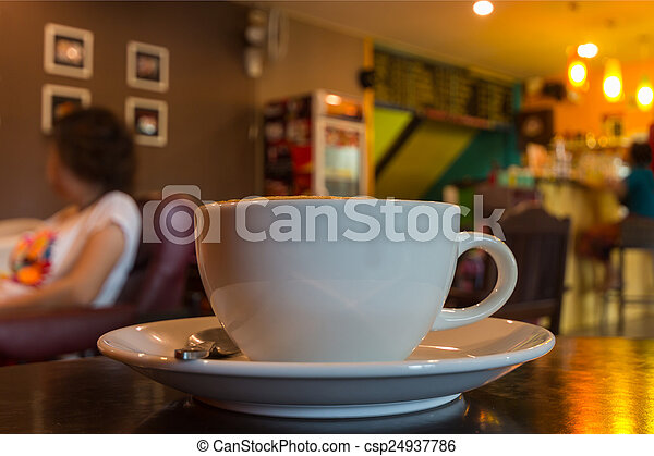 Cup of coffee on table in cafe. - csp24937786