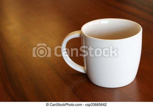 cup of coffee on the table - csp33665642