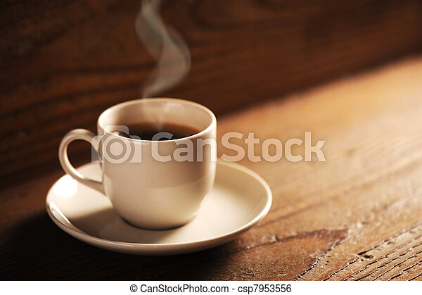 cup of coffee on the wooden table - csp7953556