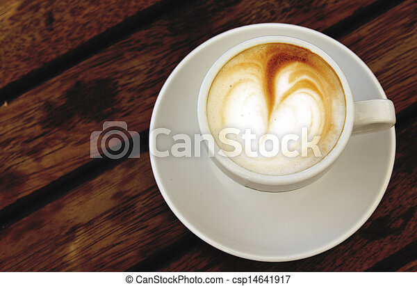 cup of coffee on wooden background - csp14641917