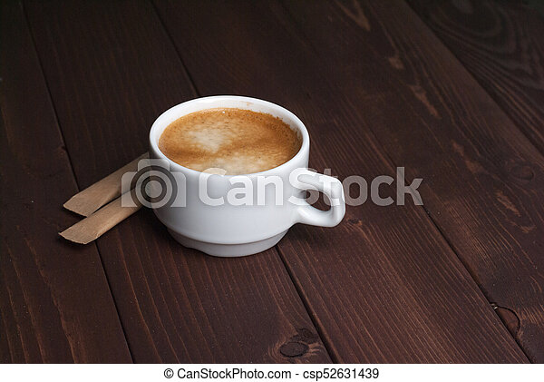 Cup of coffee on wooden background - csp52631439