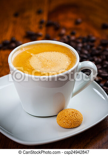Cup of coffee with beans - csp24942847