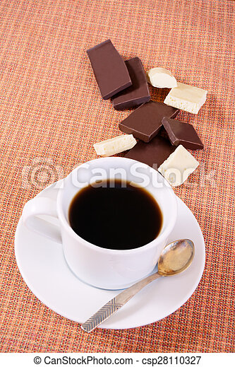 Cup of coffee with chocolate on a table - csp28110327
