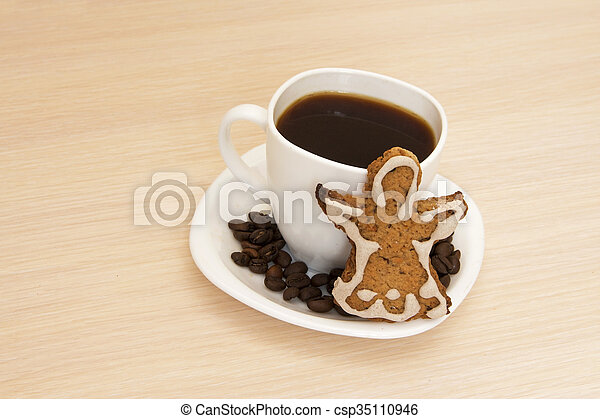 Cup of coffee with cookies on a wooden background - csp35110946