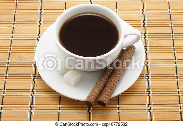 Cup of coffee with cookies on a wooden background - csp10772532