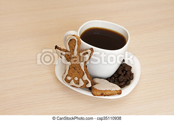 Cup of coffee with cookies on a wooden background - csp35110938
