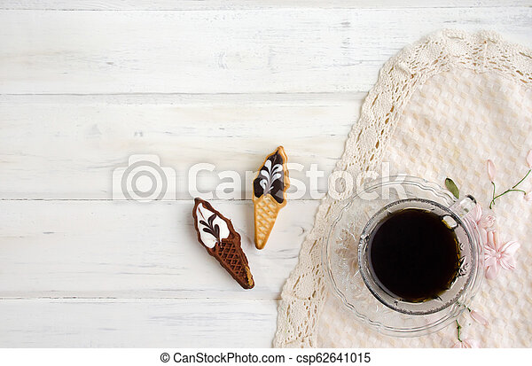 Cup of coffee with cookies. on white wooden board. - csp62641015