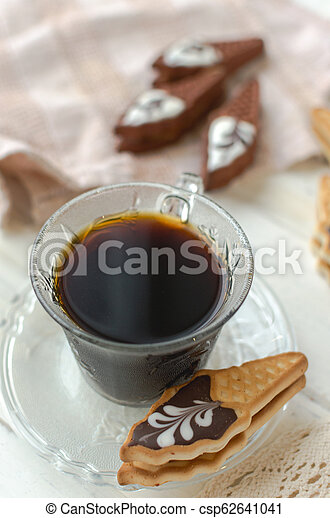 Cup of coffee with cookies. on white wooden board. - csp62641041